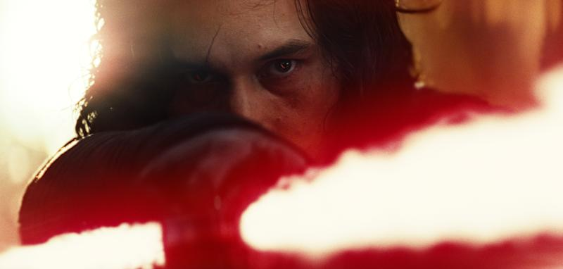 """This image released by Lucasfilm shows Adam Driver as Kylo Ren in a scene from the upcoming """"Star Wars: The Last Jedi,"""" expected in theaters in December. (Industrial Light & Magic/Lucasfilm via AP)"""
