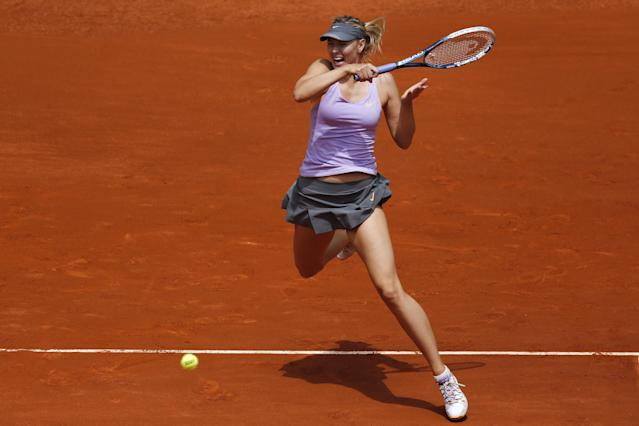 Maria Sharapova from Russia returns the ball during a Madrid Open tennis tournament match against Christina McHale from US, in Madrid, Spain, Tuesday, May 6, 2014. (AP Photo/Andres Kudacki)