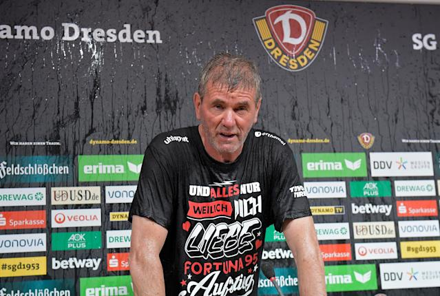 Soccer Football - 2. Bundesliga - Dynamo Dresden v Fortuna Dusseldorf - DDV-Stadion, Dresden, Germany - April 28, 2018 Fortuna Dusseldorf coach Friedhelm Funkel during a post match press conference after being soaked by his players after gaining promotion REUTERS/Matthias Rietschel DFL RULES TO LIMIT THE ONLINE USAGE DURING MATCH TIME TO 15 PICTURES PER GAME. IMAGE SEQUENCES TO SIMULATE VIDEO IS NOT ALLOWED AT ANY TIME. FOR FURTHER QUERIES PLEASE CONTACT DFL DIRECTLY AT + 49 69 650050