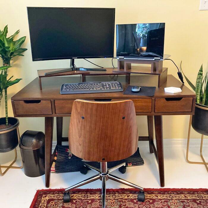 """<h2>AllModern Wilbur Desk</h2><br>Made from a mix of manufactured and solid wood, this MCM-style workspace boasts over 1,000 5-star ratings with reviewers who deem it very sturdy, well made, smooth, and beautiful.<br><br><strong>4.7 out of 5 stars and 1,684 reviews</strong><br>""""My sister purchased this desk about a year ago and loves it. So, when I had to work from home due to Covid-19, I purchased the same one. It's super easy to assemble and well made. I love it. Perfect for what I need and much better than working from the dining room table."""" <em>– Wayfair Reviewer</em><br><br><em>Shop <strong><a href=""""https://www.wayfair.com/furniture/pdp/allmodern-wilbur-desk-w003532104.html"""" rel=""""nofollow noopener"""" target=""""_blank"""" data-ylk=""""slk:Wayfair"""" class=""""link rapid-noclick-resp"""">Wayfair</a></strong></em><br><br><strong>AllModern</strong> Wilbur Desk, $, available at <a href=""""https://go.skimresources.com/?id=30283X879131&url=https%3A%2F%2Fwww.wayfair.com%2Ffurniture%2Fpdp%2Fallmodern-wilbur-desk-w003532104.html"""" rel=""""nofollow noopener"""" target=""""_blank"""" data-ylk=""""slk:Wayfair"""" class=""""link rapid-noclick-resp"""">Wayfair</a>"""
