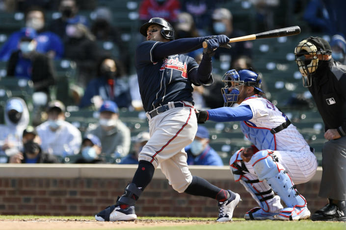 Atlanta Braves' Sean Kazmar Jr. bats during the fifth inning of a baseball game against the Chicago Cubs, Saturday, April 17, 2021, in Chicago. Kazmar Jr. returned to the major leagues after an 13-year absence, pinch hitting for the Braves. (AP Photo/Paul Beaty)
