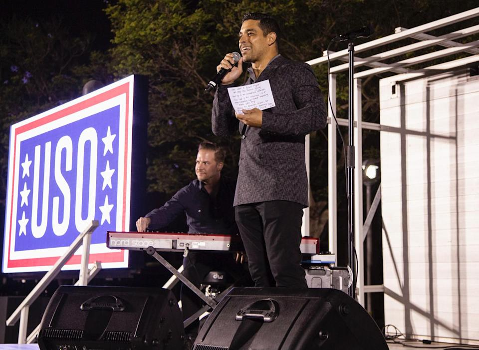 <p>Wilmer Valderrama takes the stage during the Naval Station San Diego stop with United Service Organizations and the Vice Chairman of the Joint Chiefs of Staff Air Force Gen. John E. Hyten to visit military installations around the country on June 29.</p>