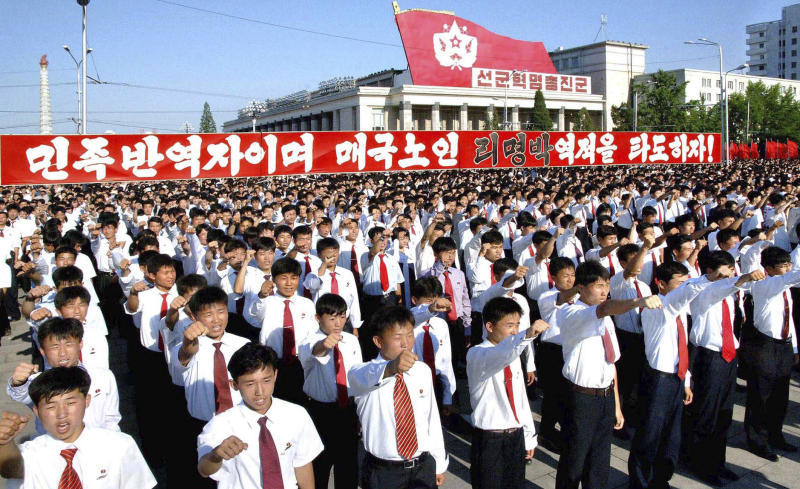 "In this photo released by Korean Central News Agency (KCNA) and distributed by Korea News Service in Tokyo, North Koreans shout slogan during  a massive rally at Kim Il Sung Square in Pyongyang, North Korea, to denounce the conservative government of South Korean President Lee Myung-bak as a ""group of unparalleled traitors"" Monday, July 4, 2011.  The North's official Korean Central News Agency said Monday that more than 100,000 citizens, soldiers and senior government and army officials flocked to the square.  (AP Photo/Korean Central News Agency via Korea News Service) JAPAN OUT UNTIL 14 DAYS AFTER THE DAY OF TRANSMISSION"