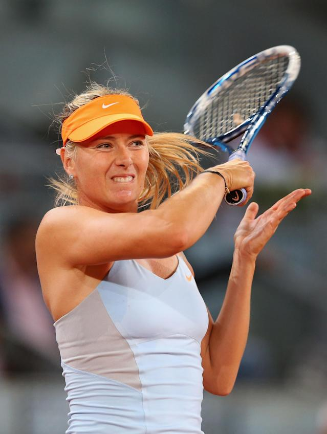 MADRID, SPAIN - MAY 07: Maria Sharapova of Russia in action against Christina McHale of USA during day four of the Mutua Madrid Open tennis tournament at the Caja Magica on May 7, 2013 in Madrid, Spain. (Photo by Julian Finney/Getty Images)