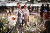 FILE - In this Jan. 27, 2021 file photo, model Kate Moss, left, and her daughter Lila Grace Moss wear a creation for Fendi's Spring-Summer 2021 Haute Couture fashion collection presented in Paris. The pandemic has torn a multibillion-dollar bite out of the fabric of Europe's luxury industry, stopped runway shows and forced brands to show their designs digitally instead. Now, amid hopes of a return to near-normality by the year's end, the industry is asking what fashion will look like as it dusts itself and struggles to its well-heeled feet again. (AP Photo/Francois Mori, File)