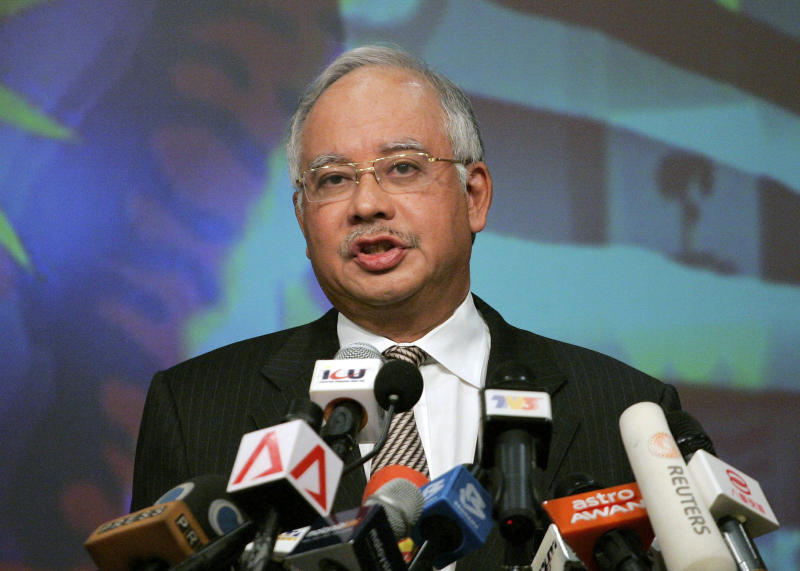 FILE - In this Thursday, April 9, 2009 file photo, Malaysian Prime Minister Najib Razak speaks during a press conference as he unveiled a new Cabinet in Putrajaya, Malaysia. Najib on Wednesday, April 3, 2013 dissolved Parliament to call for national elections expected later this month. (AP Photo/Lai Seng Sin, File)