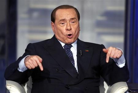 Italy's former Prime Minister Berlusconi gestures as he appears as a guest on the RAI television show Porta a Porta (Door to Door) in Rome