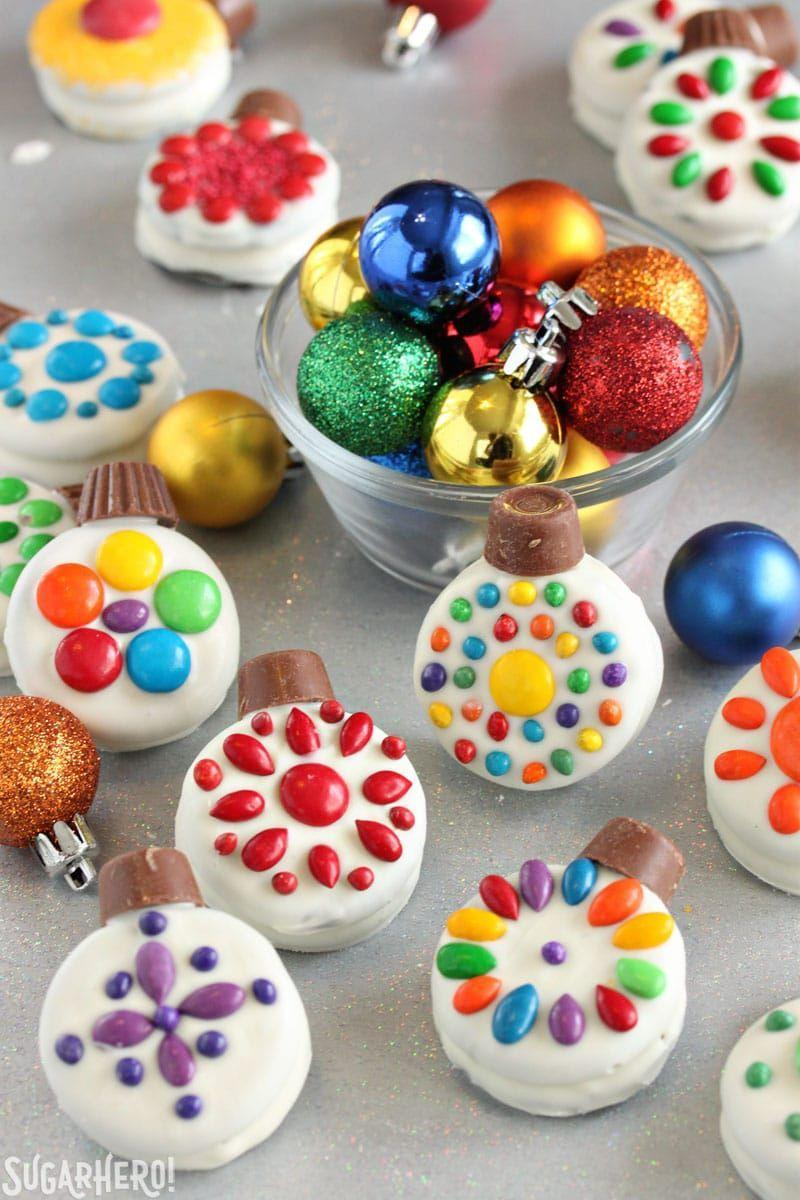 "<p>These chocolate-dipped Oreos are easy enough to decorate that even young kids can do it!</p><p><strong>Get the recipe at <a href=""https://www.sugarhero.com/oreo-cookie-christmas-ornaments/"" rel=""nofollow noopener"" target=""_blank"" data-ylk=""slk:SugarHero"" class=""link rapid-noclick-resp"">SugarHero</a>.</strong> </p>"