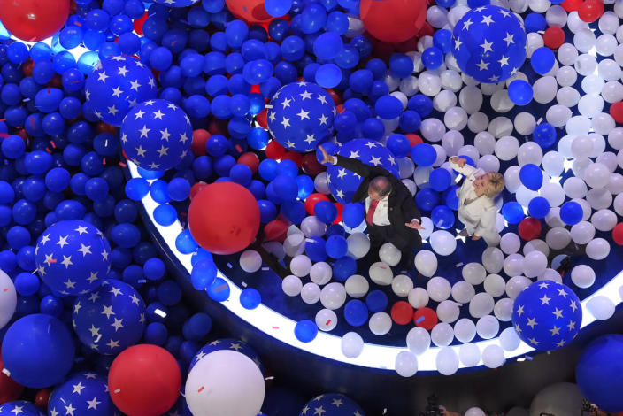 <p>Democratic presidential nominee Hillary Clinton and her running mate Democratic vice presidential nominee Sen. Tim Kaine, D-Va., walk through a sea of balloons at the conclusion of the Democratic National Convention in Philadelphia, July 29, 2016. (Photo: Mark J. Terrill/AP)</p>