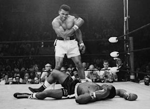 Muhammad Ali stands over fallen challenger Sonny Liston in this May 25, 1965, file photo. (AP)