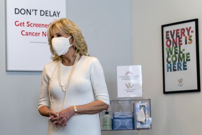 First lady Jill Biden smiles as she tours Whitman-Walker Health, Friday, Jan. 22, 2021, in Washington. (AP Photo/Jacquelyn Martin, Pool)