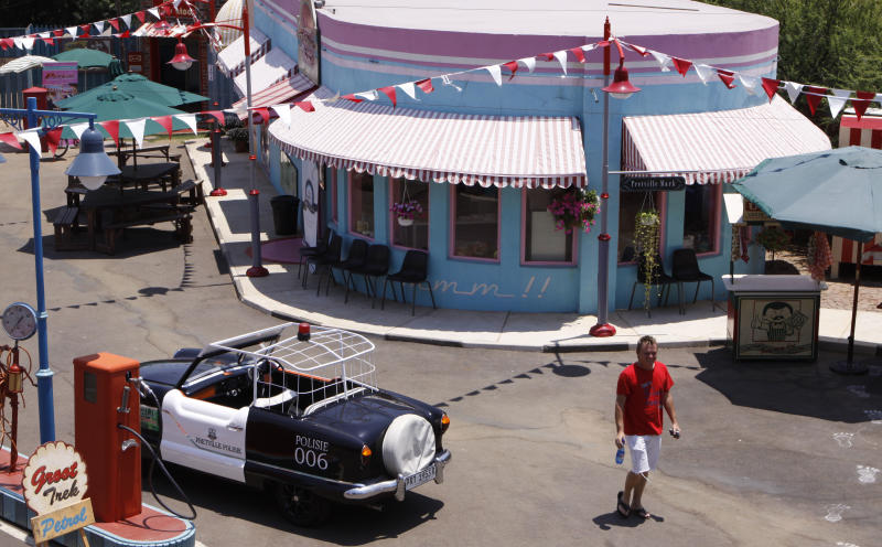 """In this photo taken Thursday, Jan. 10, 2013 part of the film set of the Afrikaans musical film """"Pretville"""" is photographed from above in Hartebeespoort, South Africa. The movie indulges in rock'n roll, vintage cars, greasers in sneakers, pin curl hairstyles and swing dresses , lots of pastel pink and blue, and double-thick strawberry milkshakes with extra cream. (AP Photo/Denis Farrell)"""