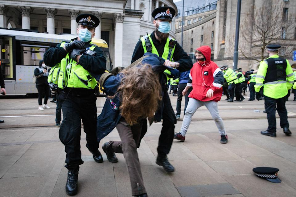 MANCHESTER, UNITED KINGDOM - 2021/03/27: Police officers arresting a protester at St Peters Square during the demonstration. People come out to the streets to protest against the new policing bill in a 'Kill The Bill demonstration'. The new legislation will give the police more powers to control protests. (Photo by Andy Barton/SOPA Images/LightRocket via Getty Images)