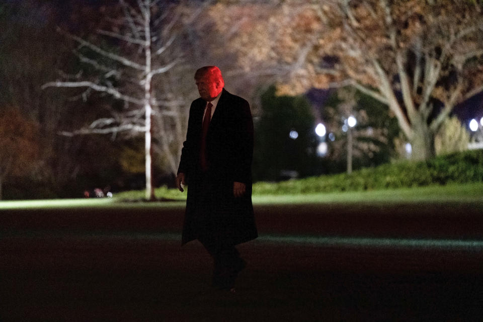 President Donald Trump walks on the South Lawn of the White House in Washington, Saturday, Dec. 12, 2020, after stepping off Marine One. Trump is returning from the Army-Navy Game at the U.S. Military Academy in West Point, N.Y. (AP Photo/Patrick Semansky)