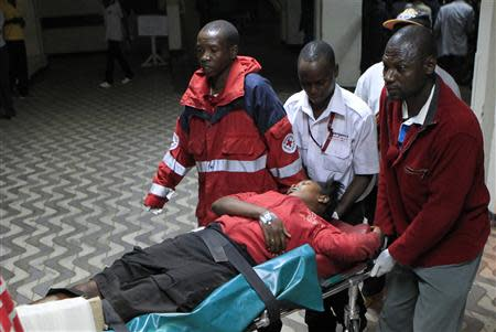 An injured blast victim arrives at Kenyatta National Hospital in Nairobi
