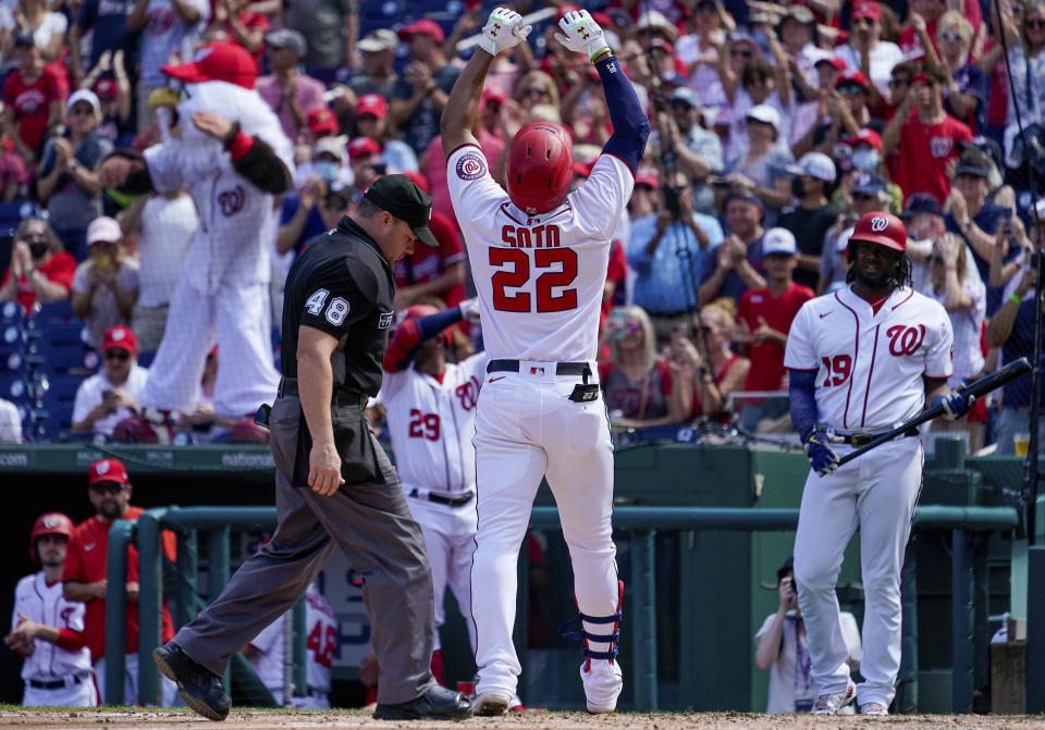 Washington Nationals' Juan Soto (22) gestures as he crosses home plate after hitting a solo home run during the third inning of a baseball game against the Colorado Rockies at Nationals Park, Sunday, Sept. 19, 2021, in Washington. (AP Photo/Andrew Harnik)