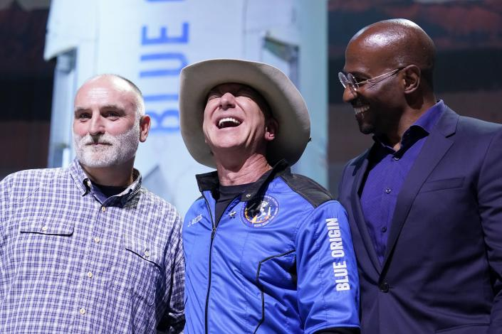 Jeff Bezos, center, founder of Amazon and space tourism company Blue Origin, poses for photos with Chef Jose Andres, left, and Van Jones, right, founder of Dream corps during a briefing following the launch of the New Shepard rocket from its spaceport near Van Horn, Texas, Tuesday, July 20, 2021. Andres and Jones were awarded Courage and Civility awards during the briefing. (AP Photo/Tony Gutierrez)