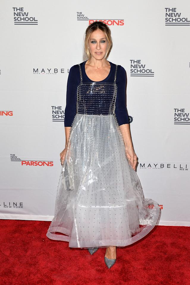 <p>Always on trend, SJP worked the dress-over-top look flawlessly at a charity event this week.<i> [Photo: Getty Images]</i></p>