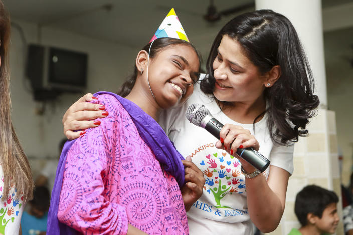 Dr. Geetanjali Chopra with a student from a school for blind children in Delhi.