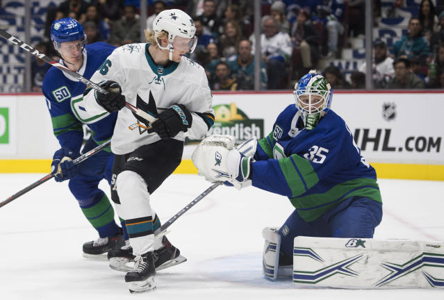 San Jose Sharks right wing Joachim Blichfeld (86) fails to get a shot past Vancouver Canucks goaltender Thatcher Demko (35) during the third period of an NHL hockey game in Vancouver, British Columbia, Saturday, Jan. 18, 2020. Vancouver Canucks defenseman Tyler Myers, left, watches the play. (Jonathan Hayward/The Canadian Press via AP)