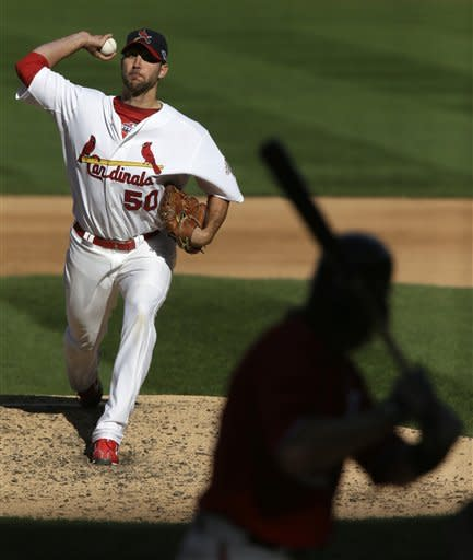 St. Louis Cardinals starting pitcher Adam Wainwright, left, throws against a Washington Nationals batter during Game 1 of the National League division baseball series on Sunday, Oct. 7, 2012, at Busch Stadium in St. Louis, Mo. (AP Photo/The St. Louis Post-Dispatch, Chris Lee) EDWARDSVILLE INTELLIGENCER OUT; THE ALTON TELEGRAPH OUT