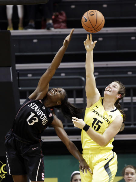 FILE - In this Feb. 1, 2013, file photo, Stanford forward Chiney Ogwumike (13) battles for a rebound with Oregon forward Liz Brenner (15) during the first half of an NCAA college basketball game in Eugene, Ore. Brenner figures she's only in college once, she might as well play the sports she loves. And for the Oregon sophomore, that's volleyball, basketball, softball and track and field — although not at once. (AP Photo/Don Ryan, File)