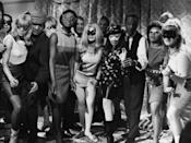 <p>Partygoers donned all types of party costumes throughout the '50s and '60s — anything to be festive, we suppose.</p>