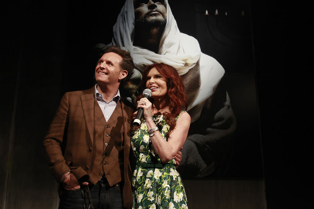 "Producer Mark Burnett and producer and actress Roma Downey speak to guests at ""The Bible Experience"" opening night gala, a rare exhibit of biblical artifacts, in New York City on Tuesday, March 19 in New York."