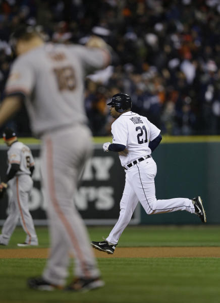 Detroit Tigers' Delmon Young runs after hitting a solo home run against San Francisco Giants starting pitcher Matt Cain during the sixth inning of Game 4 of baseball's World Series Sunday, Oct. 28, 2012, in Detroit. (AP Photo/Matt Slocum)