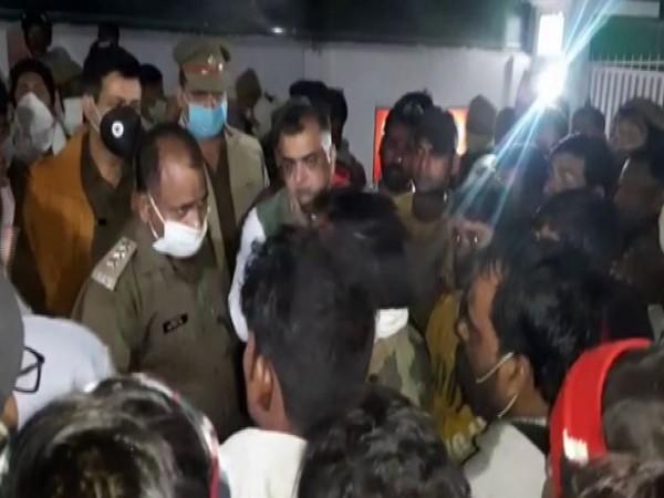 Patient's relatives create an uproar near the DM's residence in Rampur. (Photo/ANI)