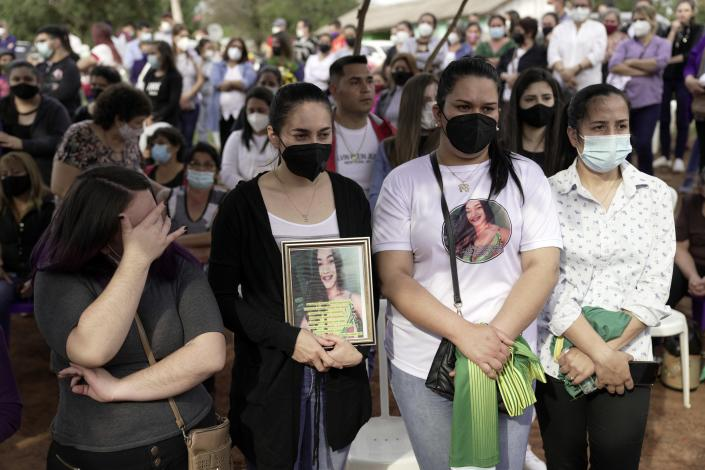 Friends and relatives of Leidy Vanessa Luna Villalba gather outside her home as the coffin that contain her remains arrives in Eugenio Garay, Paraguay, Tuesday, July 13, 2021. Luna Villalba, a nanny employed by the sister of Paraguay's first lady Silvana Lopez Moreira, was among those who died in the Champlain Towers South condominium collapse in Surfside, Florida on June 24. (AP Photo/Jorge Saenz)