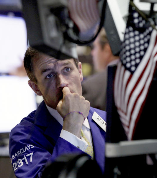 Specialist Christopher Trotta works on the floor of the New York Stock Exchange Monday, June 25, 2012. U.S. stocks are sliding at the opening of trading, following global markets lower after Spain requested help for its struggling banks. (AP Photo/Richard Drew)