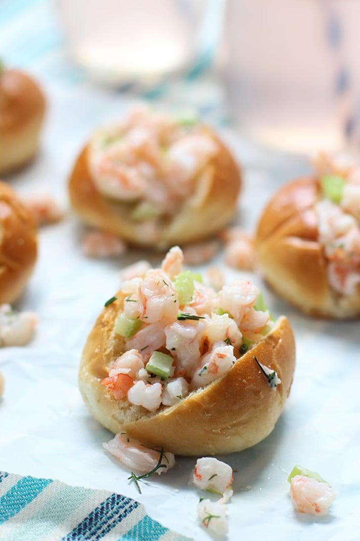 """<p>Like lobster rolls, but a bit more budget-friendly, these <a href=""""http://www.cookingforkeeps.com/2014/06/02/mini-shrimp-rolls-dill/"""" class=""""link rapid-noclick-resp"""" rel=""""nofollow noopener"""" target=""""_blank"""" data-ylk=""""slk:mini shrimp rolls"""">mini shrimp rolls</a> will bring back happy memories of the seashore.</p>"""