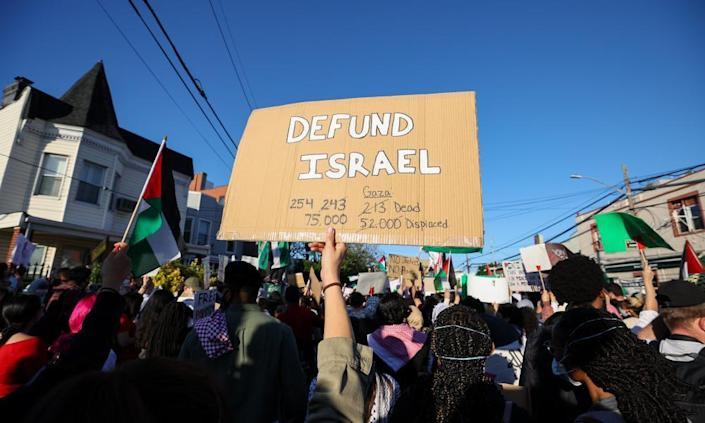 Hundreds holding banners and Palestinian flags gather in the Bronx to protest against Israeli aggression against Palestinians, in New York City last month.
