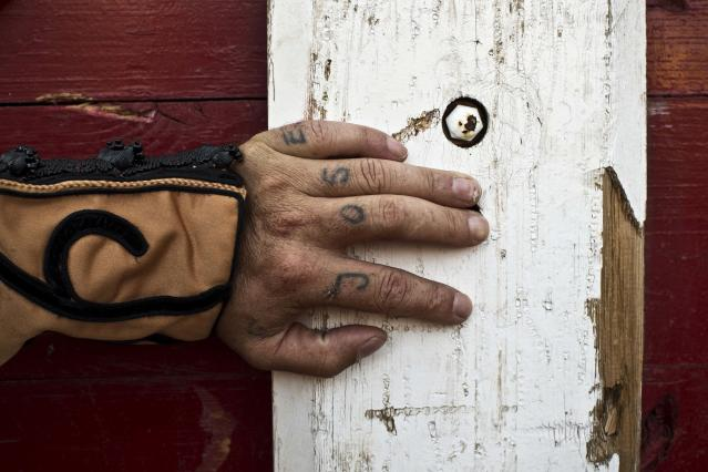 "<p>The tattooed fingers of Spanish bullfighter ""El Tatu"" as he waits for the start of a bullfight in the village of Penafiel, Aug. 15, 2013. (Photo: Daniel Ochoa de Olza/AP) </p>"