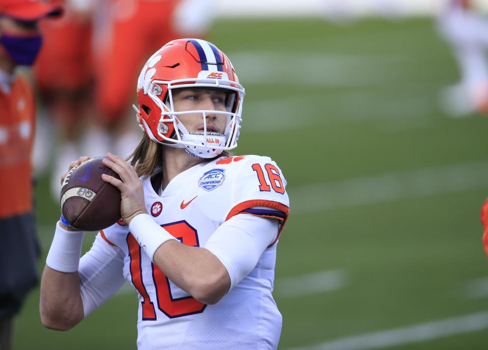 Clemson quarterback Trevor Lawrence (16) warms up before the start of the Atlantic Coast Conference championship NCAA college football game, Saturday, Dec. 19, 2020, in Charlotte, N.C. (AP Photo/Brian Blanco)