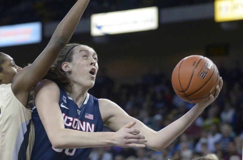 FILE - In this Jan. 1, 2014 file photo, Connecticut forward Breanna Stewart, right, goes up for a shot in front of Central Florida forward Stephanie Taylor (42) during the first half of an NCAA college basketball game in Orlando, Fla. Stewart was selected to The Associated Press women's basketball All-America team, released Tuesday, April 1, 2014. (AP Photo/Phelan M. Ebenhack, File)
