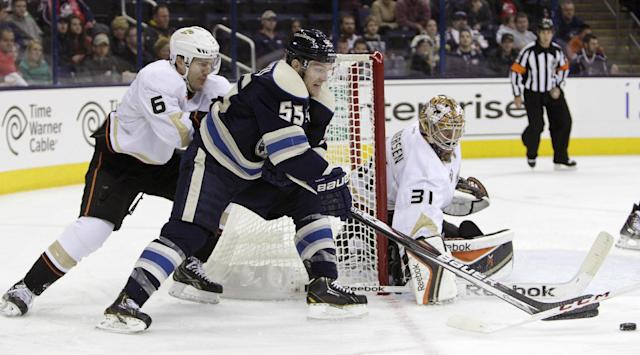 Anaheim Ducks' Frederick Andersen, right, makes a save against Columbus Blue Jackets' Mark Letestu, center, as Ben Lovejoy defends during the second period of an NHL hockey game Sunday, Oct. 27, 2013, in Columbus, Ohio. (AP Photo/Jay LaPrete)