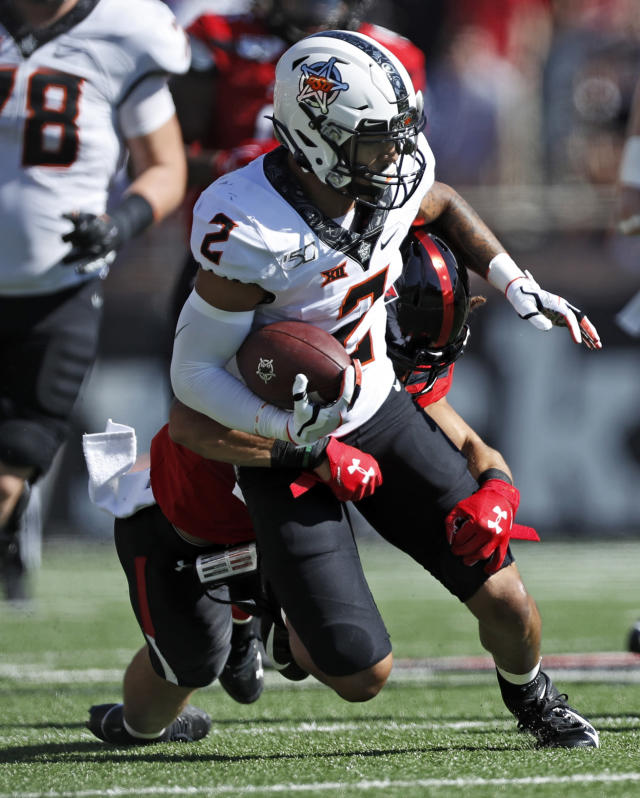 Texas Tech's Thomas Leggett (16) tackles Oklahoma State's Tylan Wallace (2) during the first half of an NCAA college football game Saturday, Oct. 5, 2019, in Lubbock, Texas. (AP Photo/Brad Tollefson)