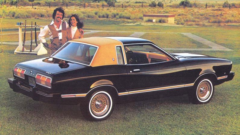 """<p><a href=""""https://www.youtube.com/watch?v=z1K88XMVT3E"""">Channeling Stefon</a>, if you're looking for a car that's apparently a Mustang, this Mustang II has everything. A landau roof, gold wheels with white wall tires, gold door trim, a man possibly in lederhosen at a rifle range. His hostage.</p>"""