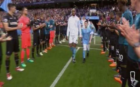 Swansea's players clap City's onto the pitch