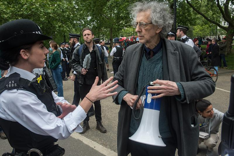 LONDON, ENGLAND - MAY 16: Piers Corbyn (brother of former Labour leader Jeremy Corbyn) is spoken to by the Police as conspiracy theorists gather at Hyde Park Corner to defy the emergency legislation and protest their claim that the Coronavirus pandemic is part of a secret conspiracy on May 16, 2020 in London, United Kingdom. The prime minister has announced the general contours of a phased exit from the current lockdown, adopted nearly two months ago in an effort curb the spread of Covid-19. (Photo by Guy Smallman/Getty images)