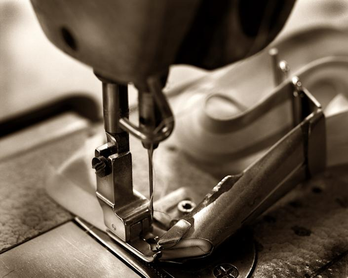 """<div class=""""caption""""> Sewing bedding in the studio. </div> <cite class=""""credit"""">Photo: Courtesy of RH</cite>"""