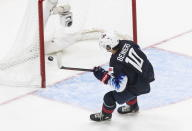 FILE - In this Jan. 2, 2021, file photo, United States' Matthew Beniers (10) scores an empty net goal against Slovakia during the third period of an IIHL World Junior Hockey Championship game in Edmonton, Alberta. Ann Arbor, Michigan, became a must-stop on the scouting trail because of a buzz-worthy Wolverines lineup featuring a trio of highly touted freshmen in defenseman Owen Power, and forwards Kent Johnson and Mathew Beniers. (Jason Franson/The Canadian Press via AP, File)