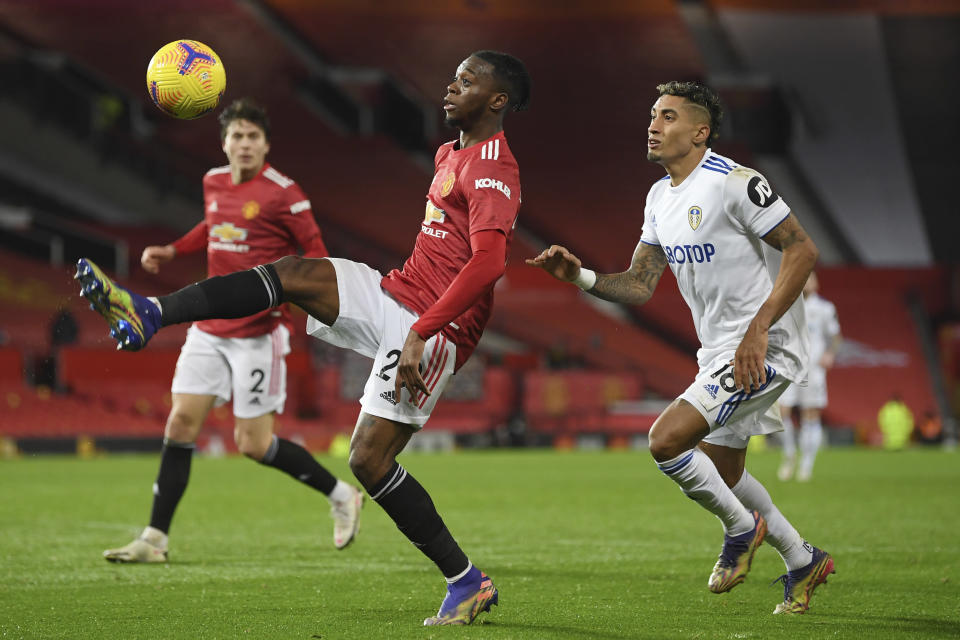 Manchester United's Victor Lindelof controls the ball in front of Leeds United's Raphinha during an English Premier League soccer match between Manchester United and Leeds United at the Old Trafford stadium in Manchester, England, Sunday Dec. 20, 2020. (Michael Regan/Pool via AP)