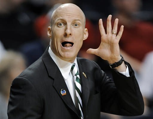 Ohio coach John Groce yells to his players in the first half of a third-round NCAA college basketball tournament game against South Florida on Sunday, March 18, 2012, in Nashville, Tenn. (AP Photo/Donn Jones)