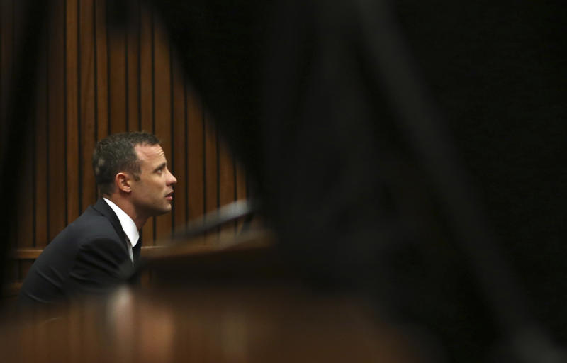 Oscar Pistorius sits in the dock while listening to ballistic evidence being given in court in Pretoria, South Africa, Wednesday, March 19, 2014. Pistorius is on trial for the murder of his girlfriend Reeva Steenkamp on Valentine's Day in 2013. (AP Photo/Themba Hadebe, Pool)