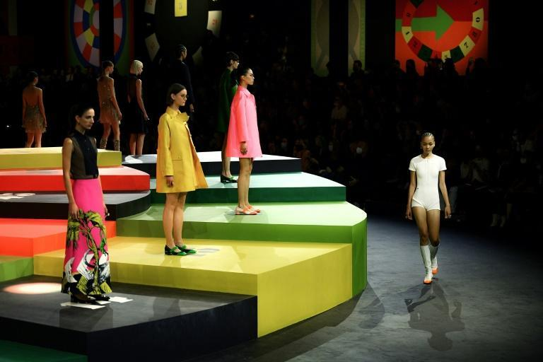 The game show-style stage was as bright and colourful as the clothes. (AFP/Christophe ARCHAMBAULT)