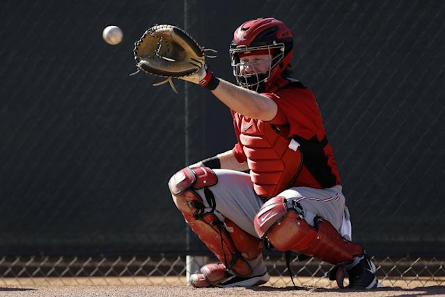 FILE - In this Feb. 16, 2013 file photo, Cincinnati Reds catcher Ryan Hanigan catches a ball during spring training baseball in Goodyear, Ariz. In a deal that was announced Dec. 3, 2013, Ryan Hanigan agreed to a $10.75 million, thee-year contract with the Tampa Bay Rays that runs through 2016 and includes a club option for 2017. (AP Photo/Paul Sancya, File)