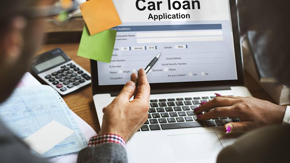 Men viewing car loan finance application on laptop